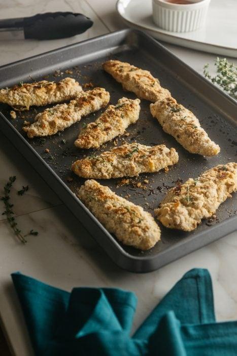 keto chicken tenders on a baking sheet