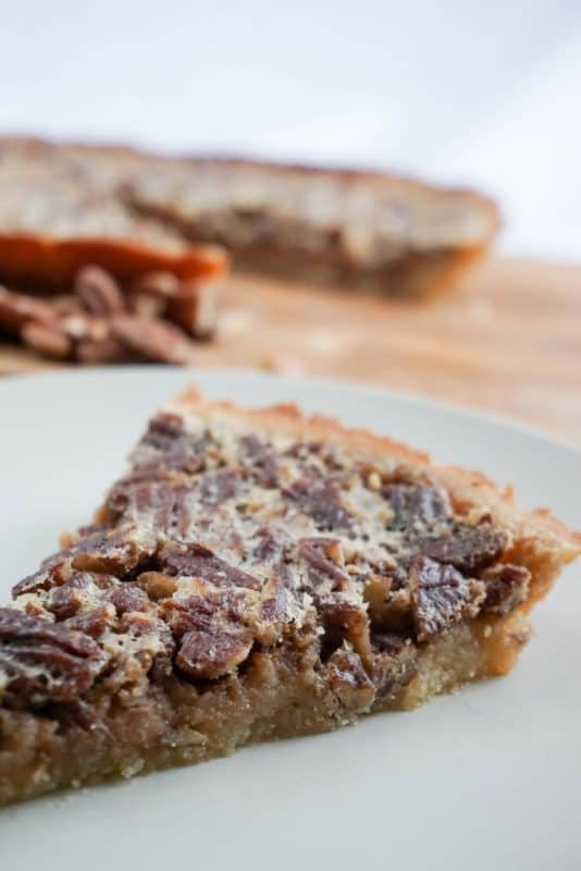Our low carb pecan pie recipe is delicious, and the secret is the sugar-free maple syrup, and coconut flour pie crust.
