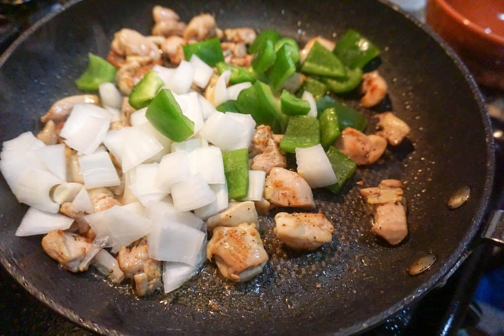 veggies for easy cashew chicken being sauteed in preparation for the final dish