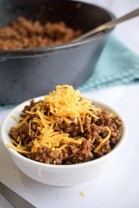 Keto chili with bacon and melted cheese on top KetoConnect
