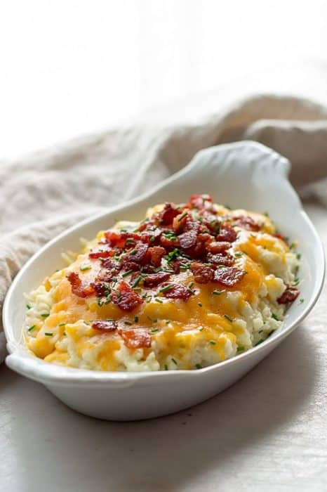 keto appetizers loaded cauliflower with cheese and bacon on top