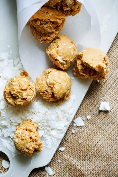 no bake peanut butter cookies displayed on a piece of parchment paper
