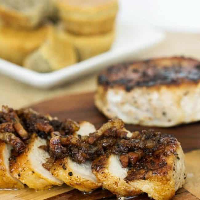 apple pork chops on cutting board