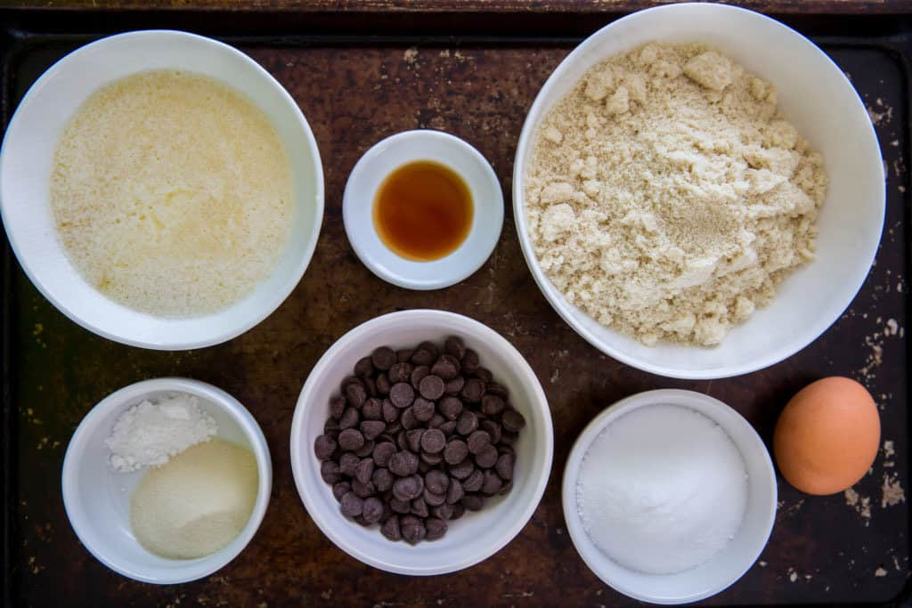 All the ingredients you will need for keto chocolate chip cookies portioned out into bowls.