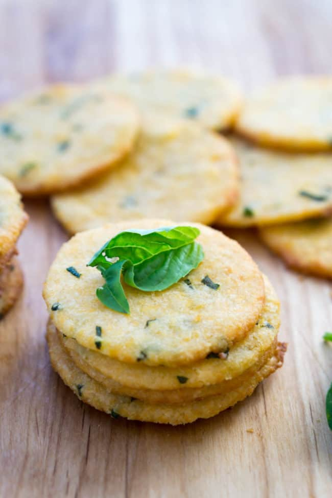 cheese crackers with fresh basil on top