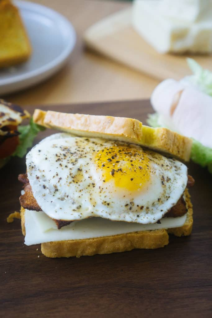 These keto break breakfast sandwiches use our best keto bread recipe and filling ingredients like eggs, meat and cheese!