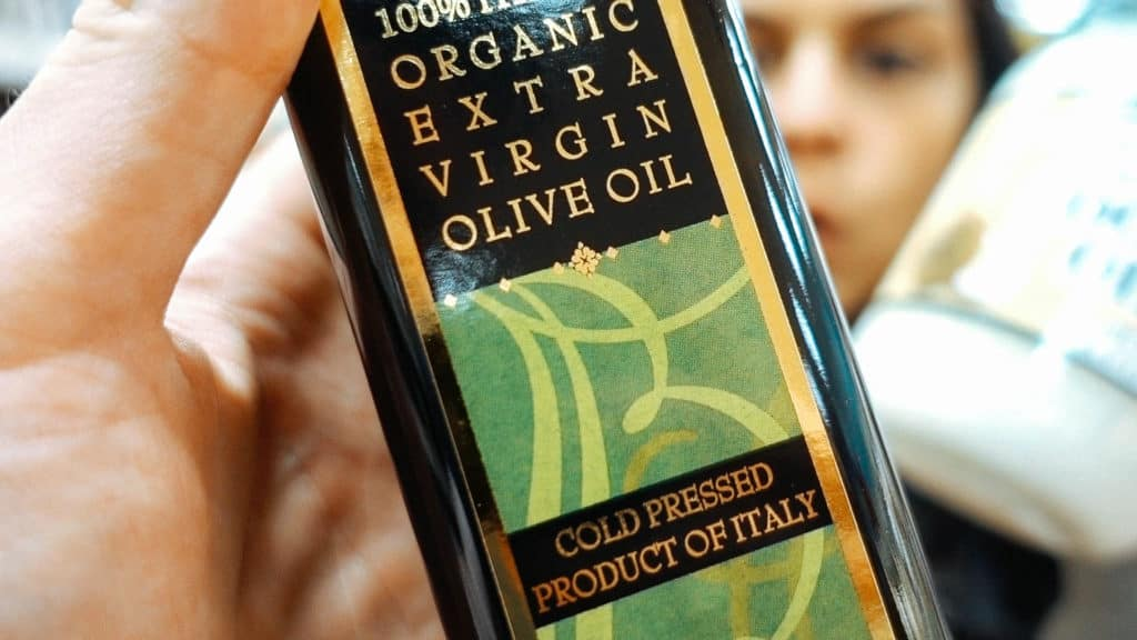 extra virgin olive oil in a dark bottle at trader joes