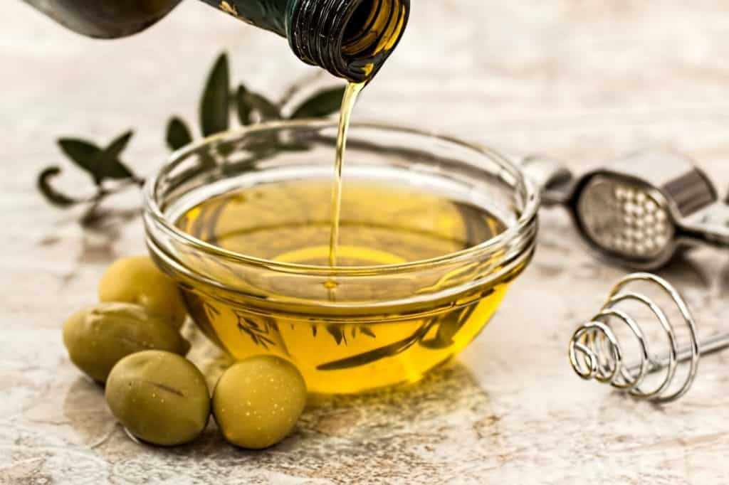 Olive oil can be both good and bad, extra-virgin olive oil is the best version of olive oil as it contains all the different health benefits. We explain each version of olive oil and the benefits and drawbacks of each!