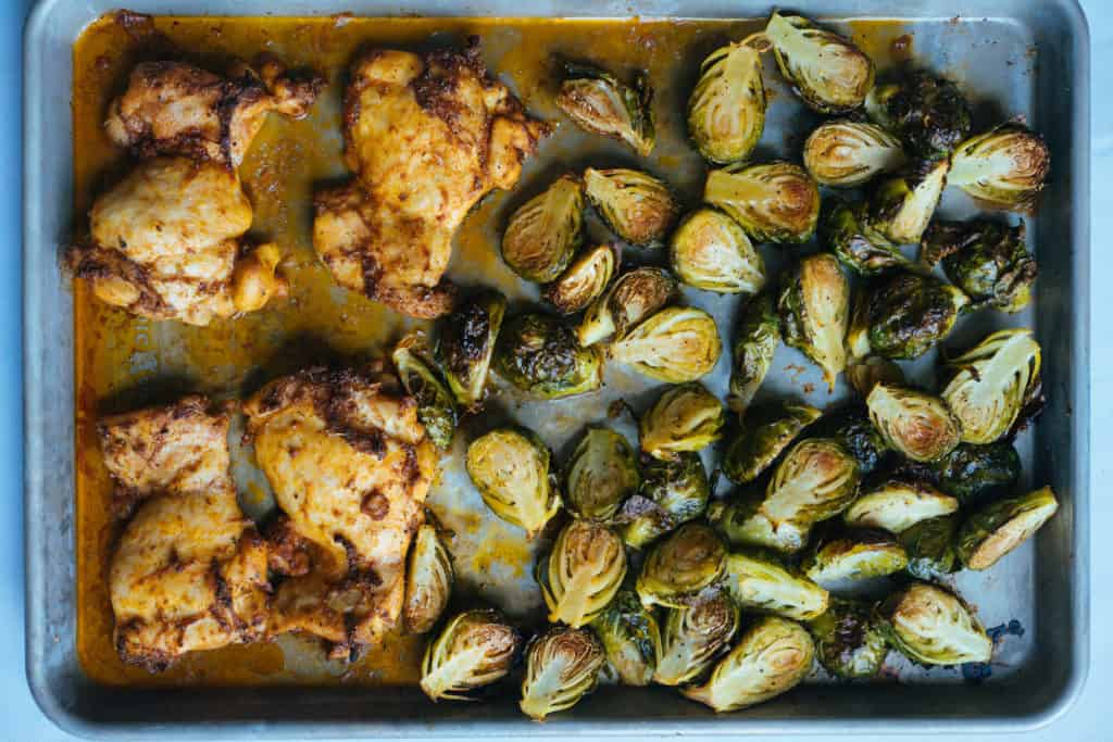 This One Sheet Chicken Dinner uses a flavorful peri peri rub and hearty brussels sprouts to feed and satisfy your family on busy weeknights!