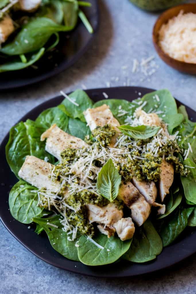 This Easy Pesto Chicken Recipe is packed with tons of different flavors and textures and takes less than 30 minutes to whip up any night of the week! Delicious and Keto Friendly!