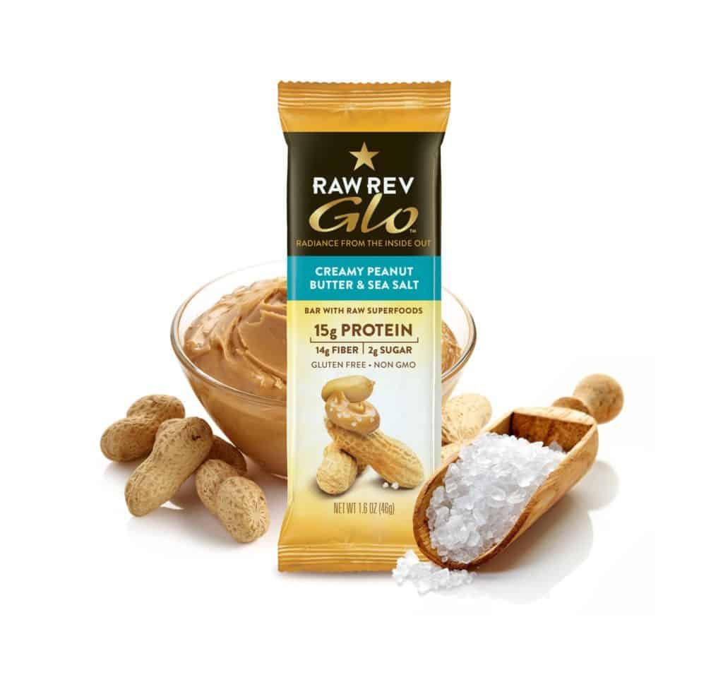 packaged bar in a posed photograph with peanuts peanut butter and salt around it