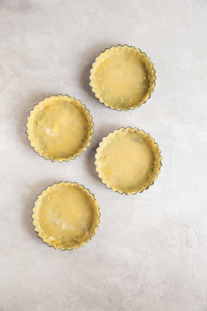 keto pie crust formed into tart pans which makes it easier to remove after baking