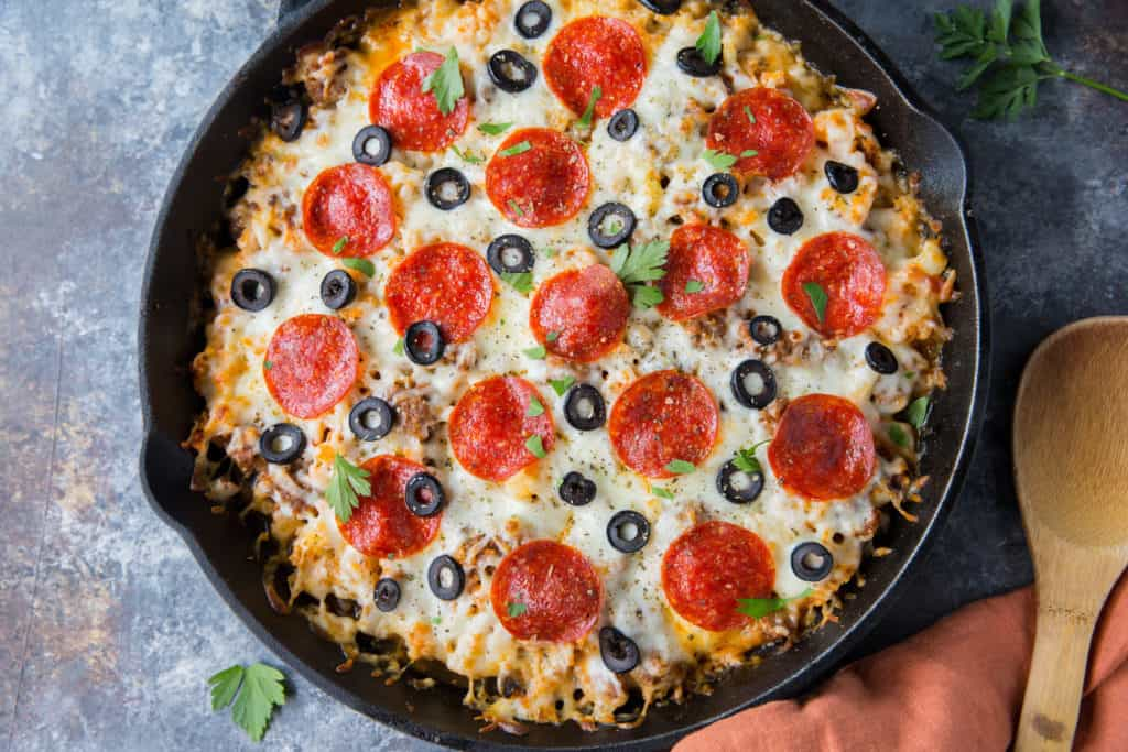 Our keto pizza casserole combines hearty sausage, tender cauliflower, cheese, and pepperoni to make a delicious final product. Making this pizza casserole can be turned into a whole family time activity!