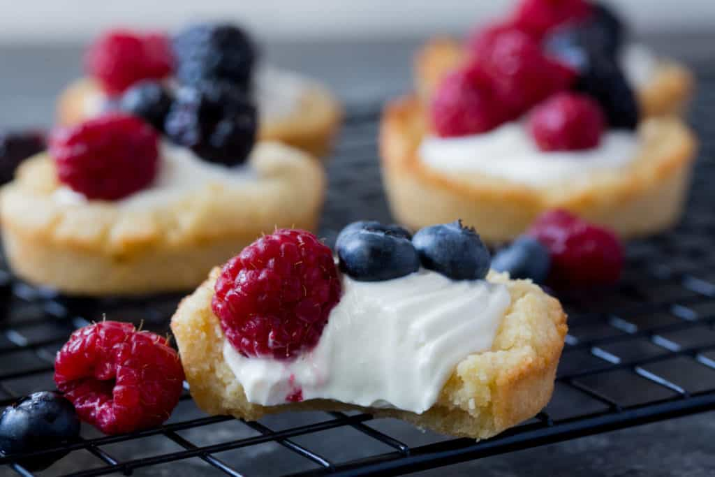 These berry topped cream filled keto sugar cookies are a perfect holiday treat!
