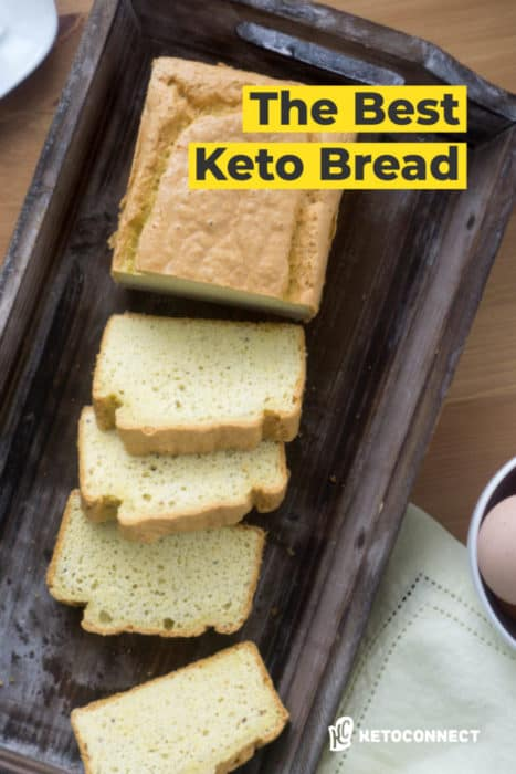 sliced loaf of keto bread displayed on a cutting board