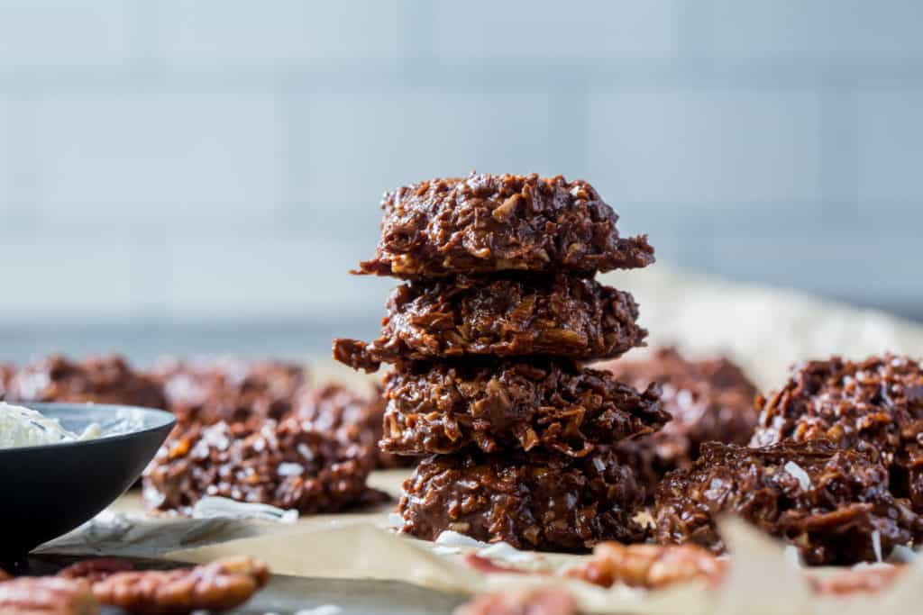 keto no bake cookies stacked for presentation with other keto cookies resting in the background