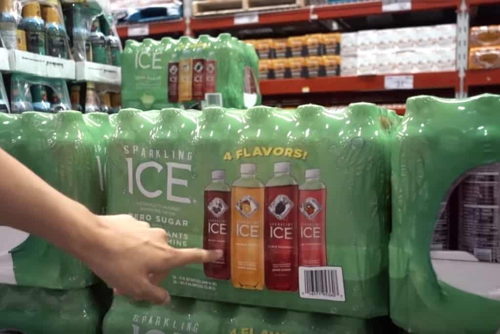 A woman's hand pointing to a bulk pack of Sparkling Ice zero-calorie sodas on sale at Sam's Club.