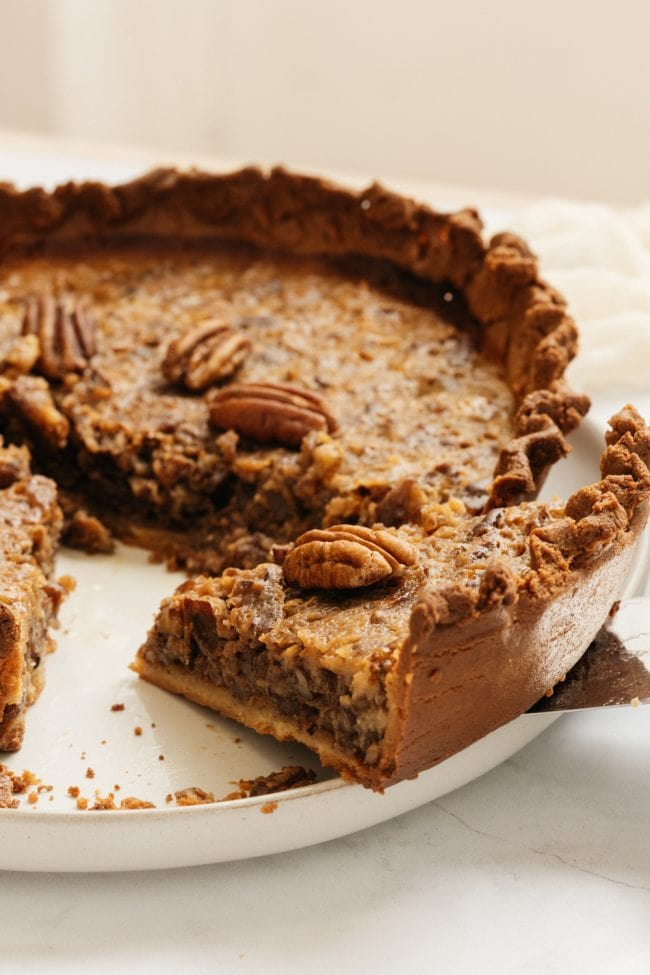 keto pecan pie being sliced on a plate
