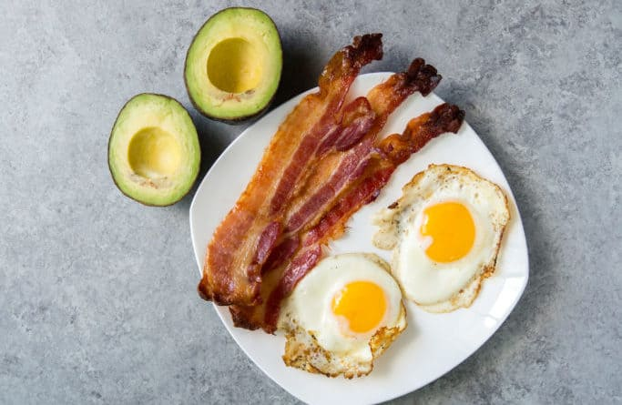 paleo vs keto breakfast showing avocados bacon and eggs