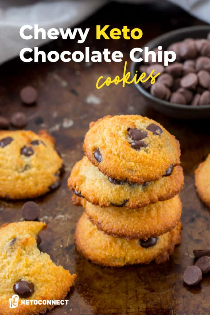 keto chocolate chip cookies stacked on top of each other in front of a small bowl of chocolate chips