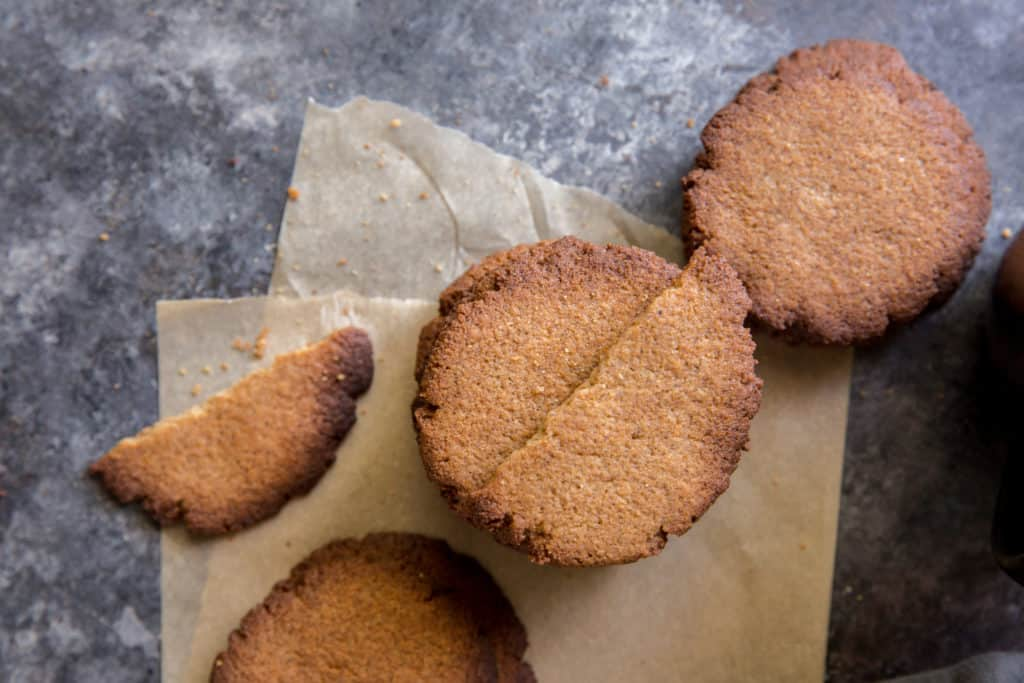 three stacks of keto ginger cookies on a piece of parchment paper
