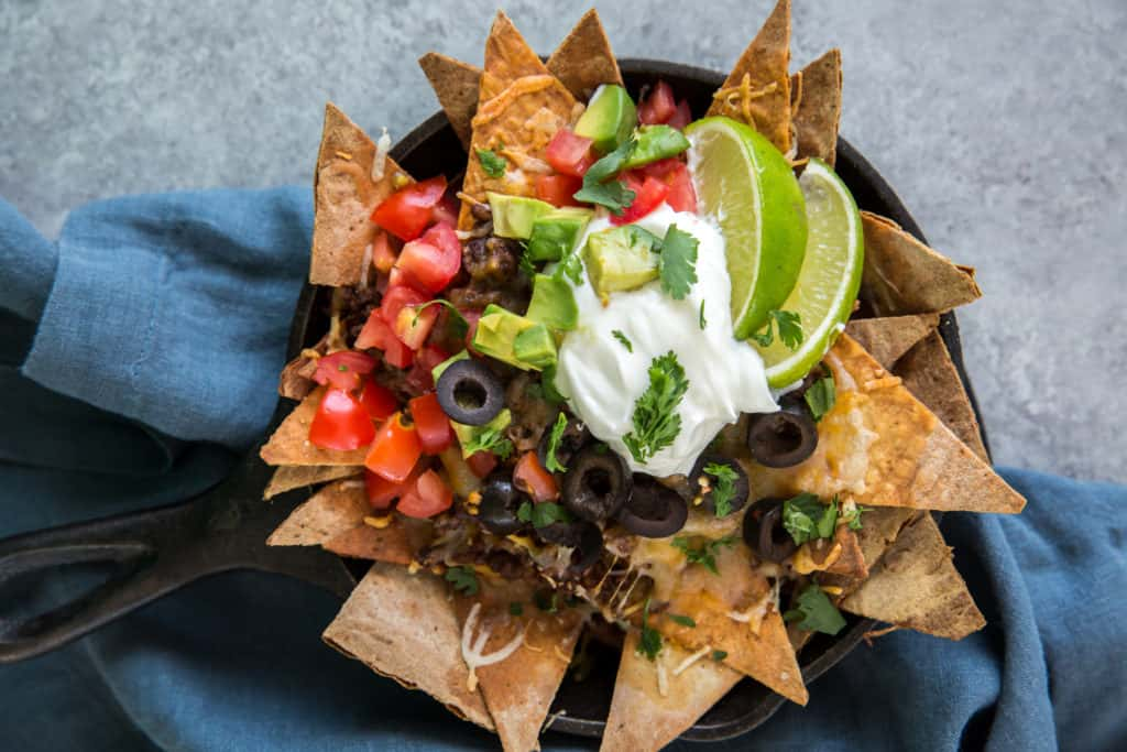 keto nachos with low carb tortilla chips served in a cast iron skillet