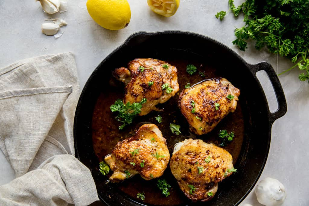 chicken thighs in a large cast iron skillet
