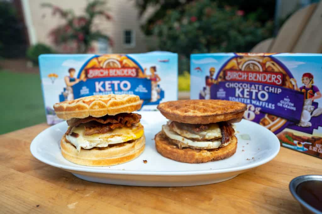 two keto breakfast sandwiches on a plate with maple syrup