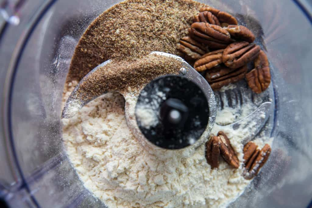 the ingredients to make keto energy balls in a food processor