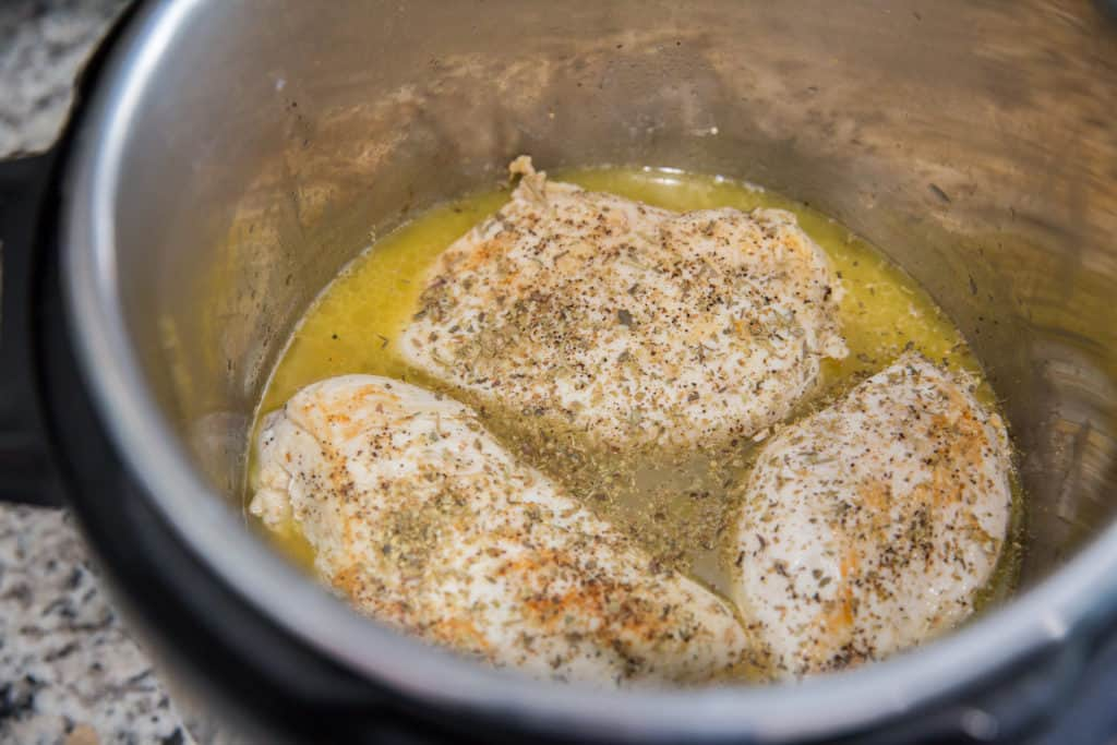 chicken breasts seasoned and cooked in a creamy butter sauce in the instant pot