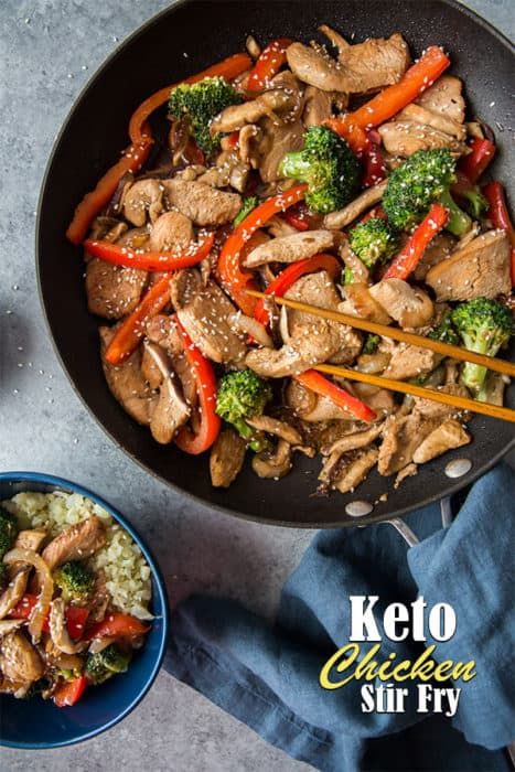 keto chicken stir fry in a frying pan and also plated over cauliflower rice