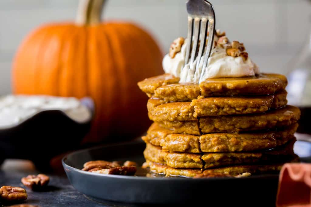 pumpkin pancakes sliced with a fork