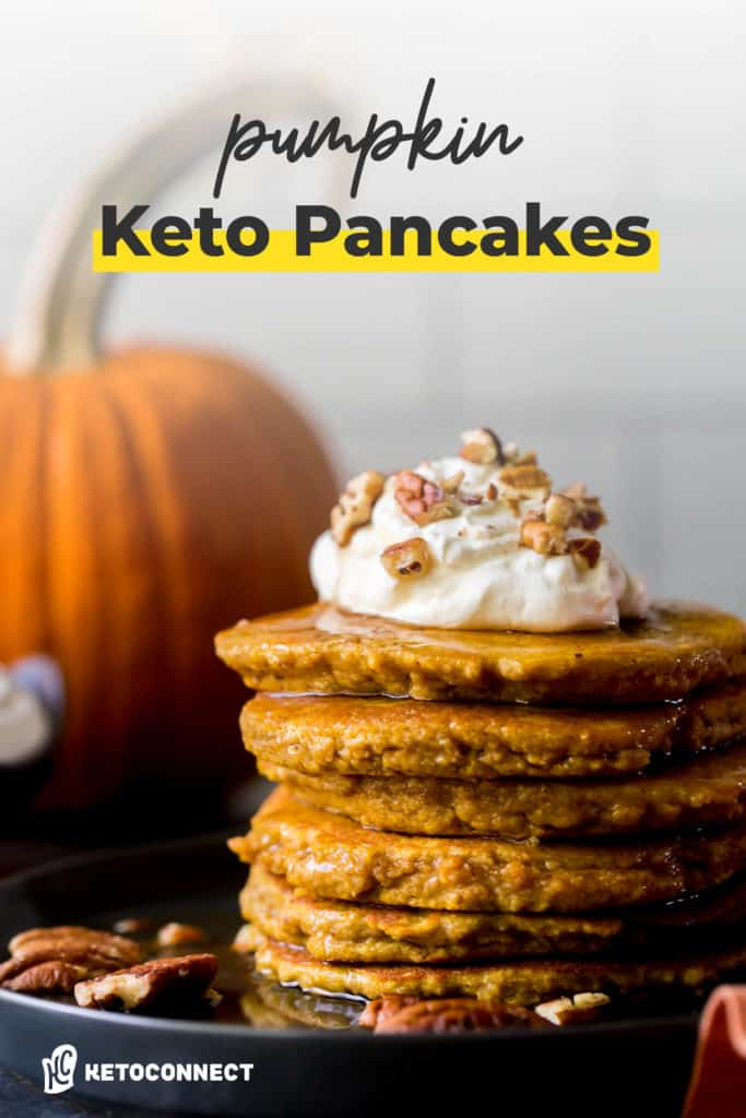 whip cream topped pancakes with pumpkin