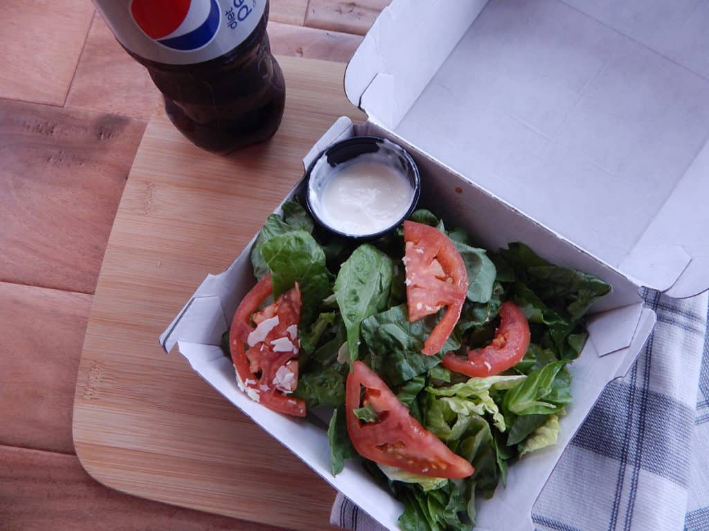 Garden Salad next to a diet pepsi