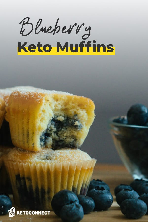 blueberry muffin stacked on top of each other with a bite out of it
