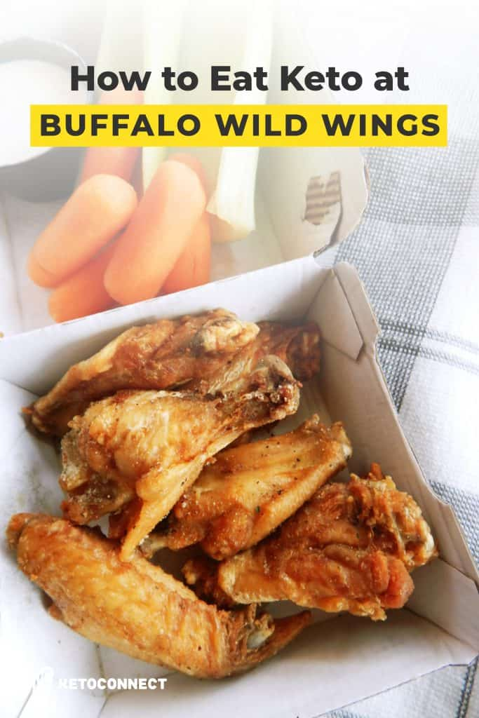 fried wings in a takeout box with carrots