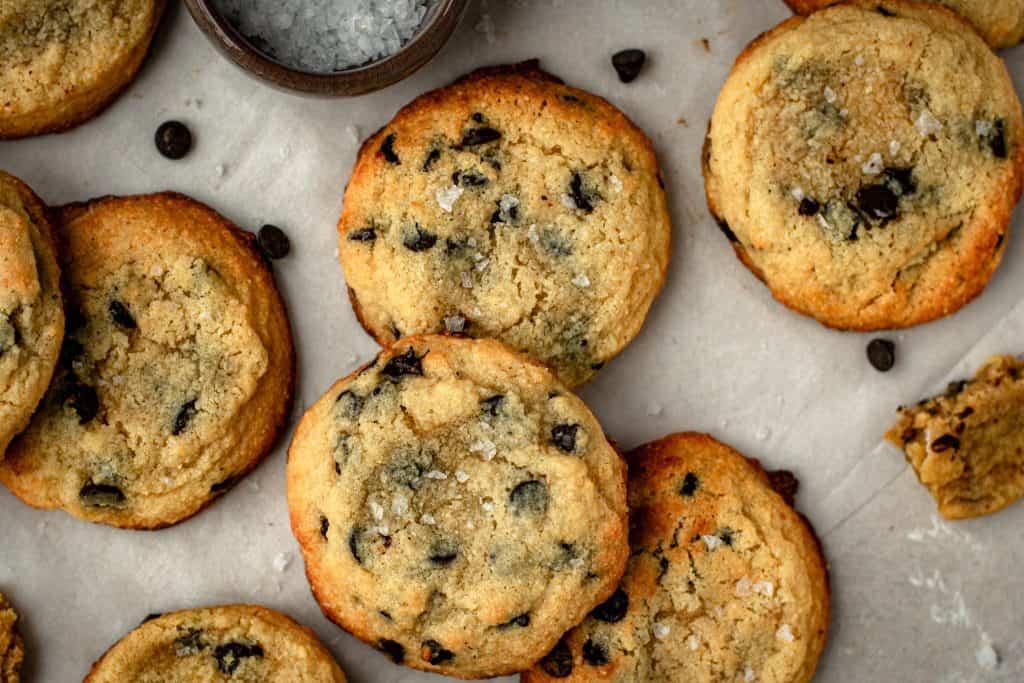 Tray of cookies next to flakey salt.