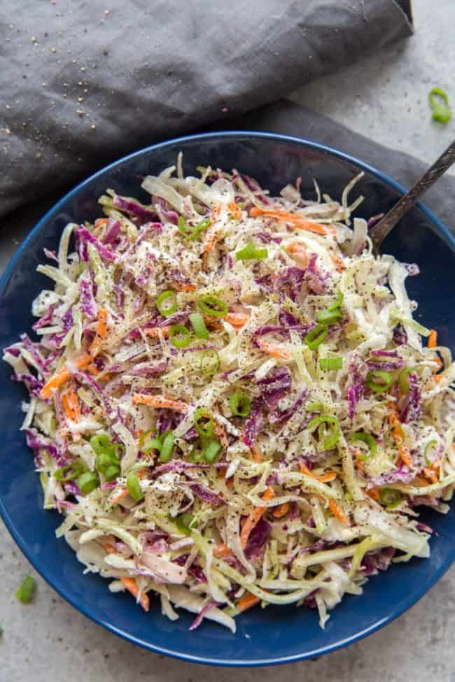 keto coleslaw in a bowl with a serving spoon
