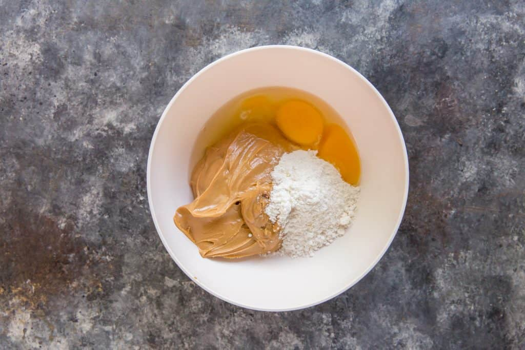 All Peanut Butter Cookie Ingredients in a bowl to mix together