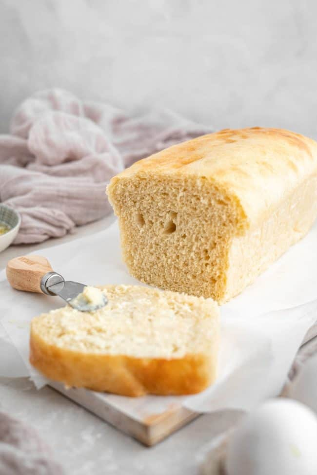 A side shot of low carb bread with a knife