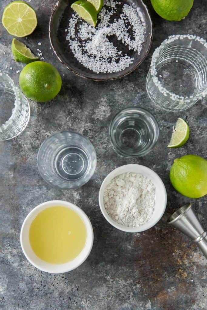 All glasses and ingredients to make keto margaritas with fresh lime juice.