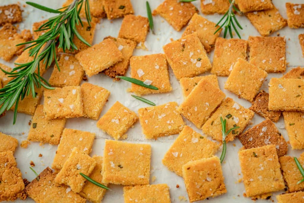 close up keto crackers on parchment paper