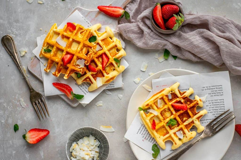 Keto protein waffles plated and topped so they are ready to serve.