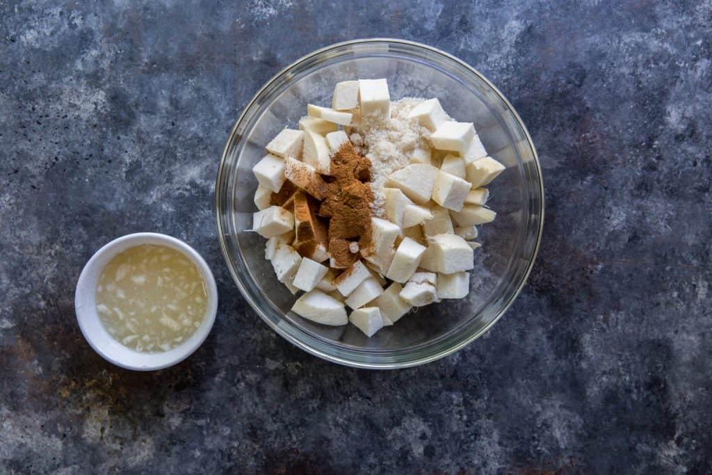 A glass bowl with chunks of jicima and cinnamon