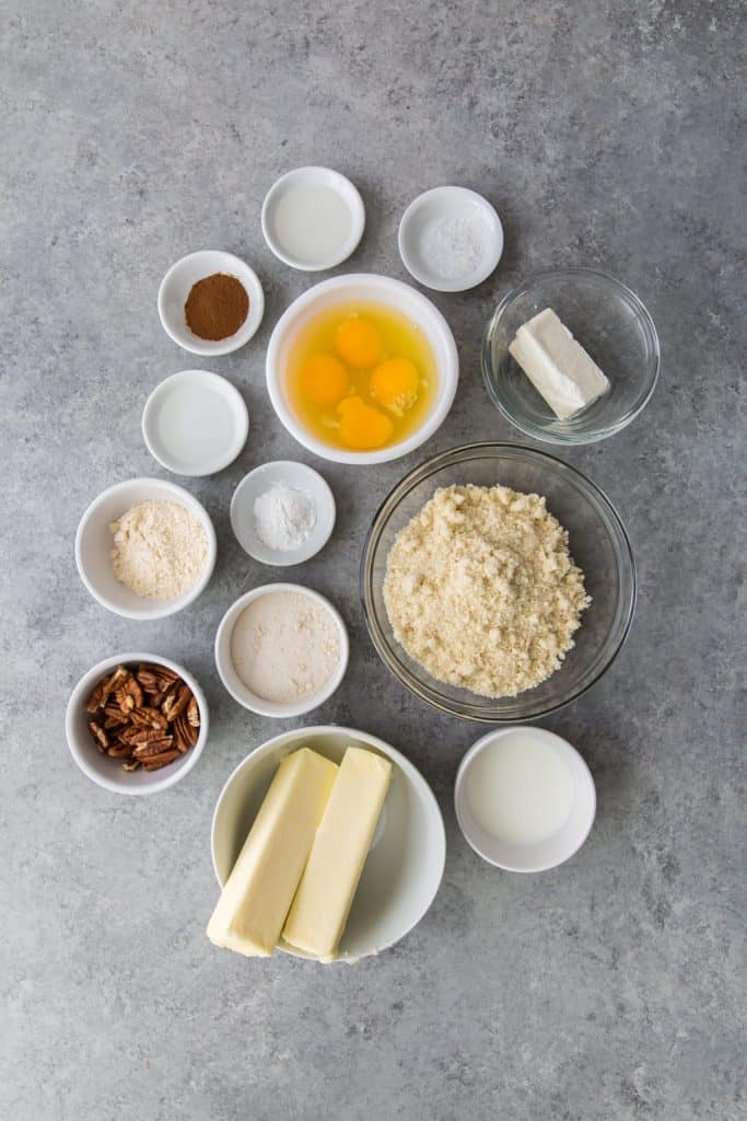 ingredients for keto banana bread in ceramic and glass bowls