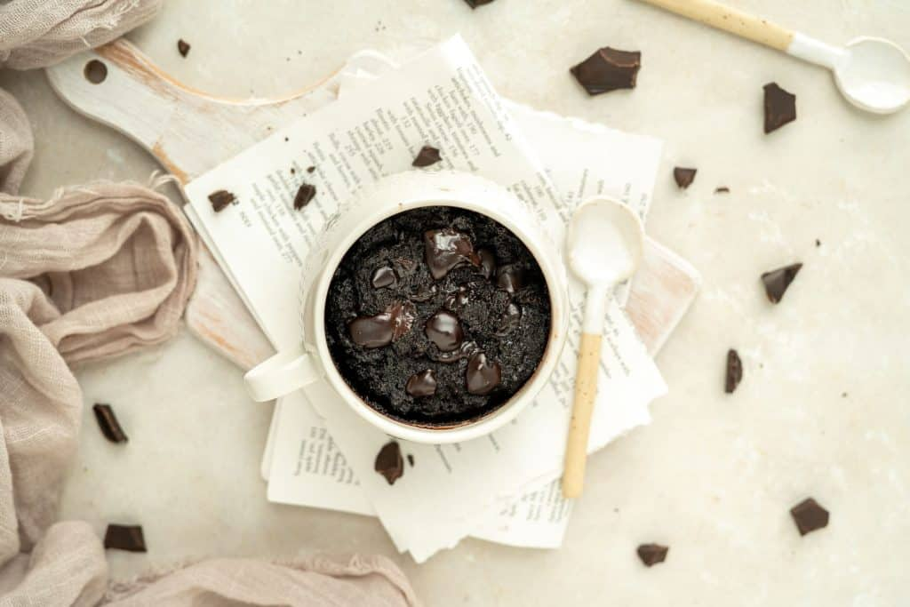 a white mug filled with dark chocolate and brownie