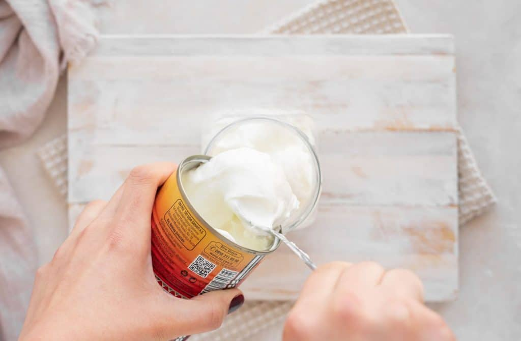 Adding coconut cream into a jar