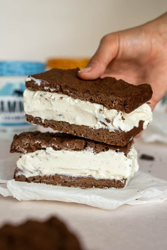 hand placing a second ice cream sandwich on top of the first