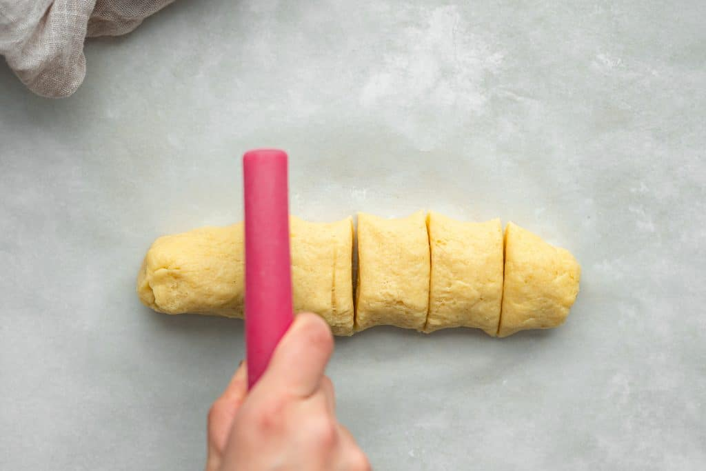 cutting the dough into equal portions before forming into rings