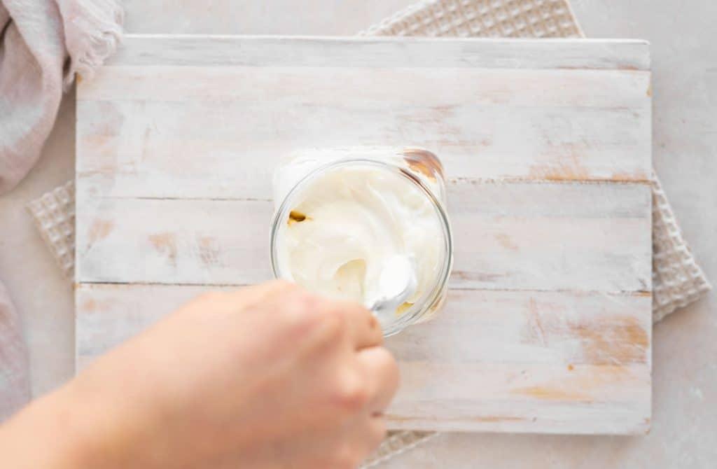 Stirring keto yogurt with probiotic